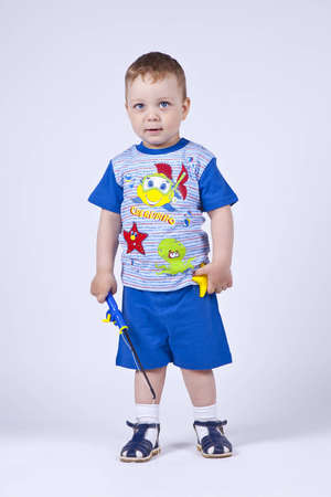 portrait of a little cute boy in a blue suit in studio Stock Photo