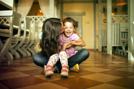 naivety: Mum with a daughter sit on a floor  Stock Photo
