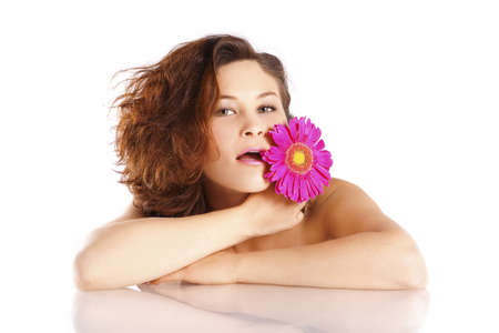 Girl with a flower on a white background in the studio Stock Photo - 12685088