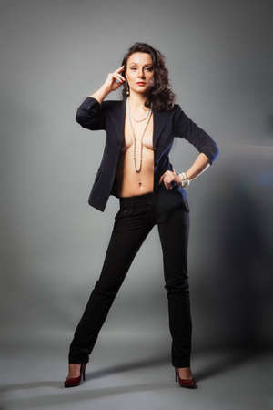girl in a pantsuit, jacket over her body and posing photo
