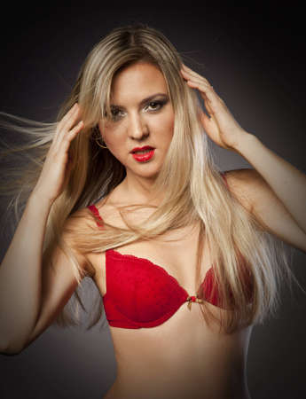blonde girl with hair vrazlet posing in the studio Stock Photo - 12685192