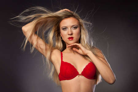 blonde girl with hair vrazlet posing in the studio photo