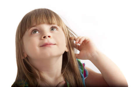 put forward: little girl with large gray eyes looking up Stock Photo