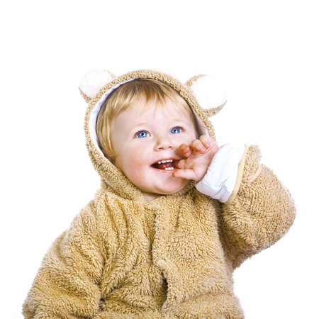 a little boy in a yellow fur suit on a white background in studio Stock Photo