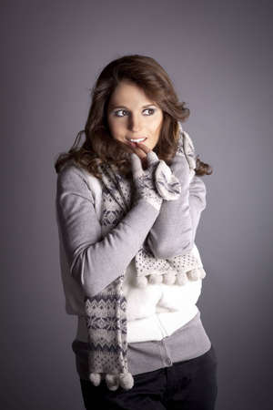 young woman in a sweater and gloves with long brown hair photo