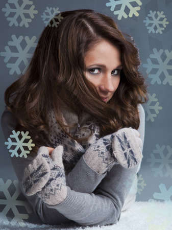 young woman in a sweater and gloves with long brown hair Stock Photo - 12922241
