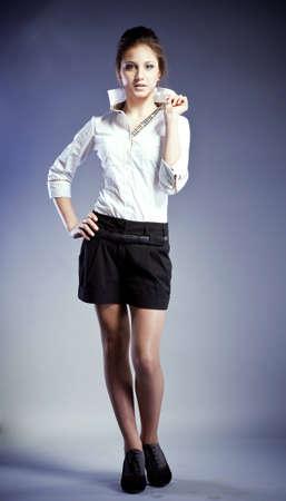 beautiful young woman, blue eyes, brown hair, a white blouse, short black shorts,