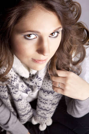 young woman with a scarf around the neck sweater, close-up Stock Photo - 13066091