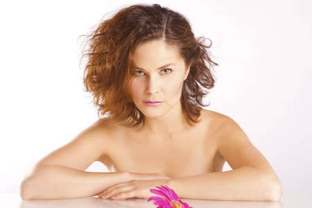 Girl with a flower and luxurious brown hair