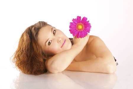 Girl with a flower and luxurious brown hair photo