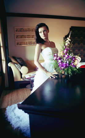young woman in a chic wedding dress photo