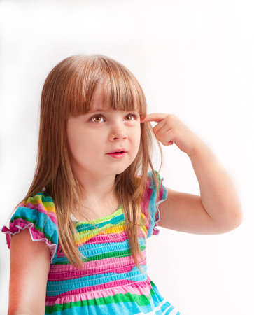 little girl in a dress the color posing in studio Stock Photo - 13675866