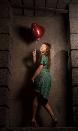 young woman holding a ball in the form of heart