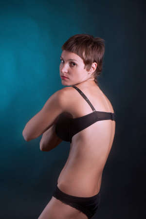 young woman in a swimsuit posing in studio Stock Photo