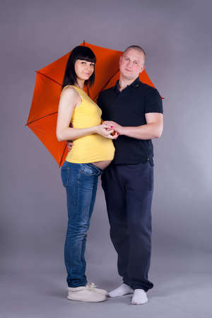 couple in love with a red umbrella photo