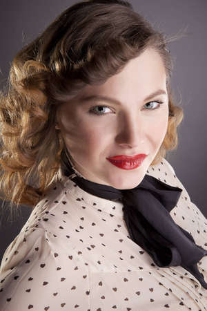 The girl the brown-haired woman with a black bow-tie poses in studio