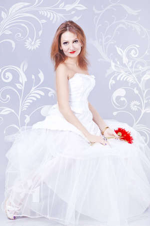A young woman in a white wedding dress Stock Photo