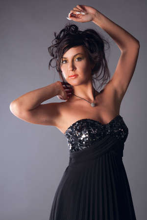 young girl in a black dress with shiny bras