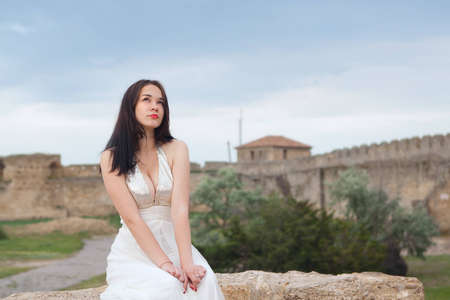 A young woman dressed in white against the sky Stock Photo - 13366224