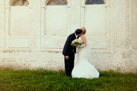 wedding couple on a white background of a brick wall