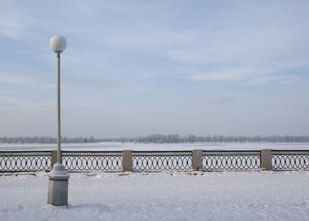 parapet: Street lamp on the embankment with parapet in winter