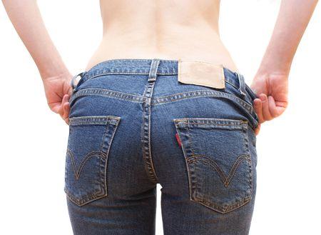 tight jeans: Backshot de jeune fille portait un jean bleu