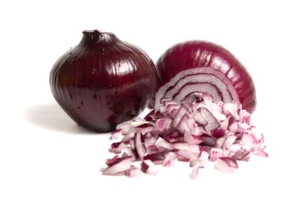 Whole and cuted bulbs of red onion isolated