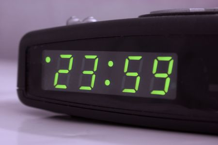 Digital Tabletop Clock Showing One Minute To Midnight 23.59 Stock Photo    6854120