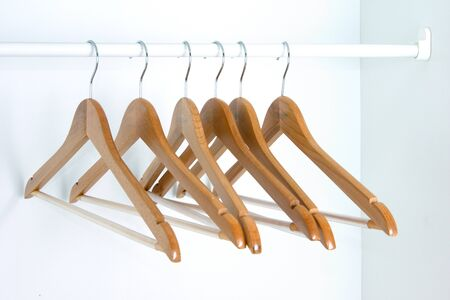 closet: rail with six shoulders with no clothes