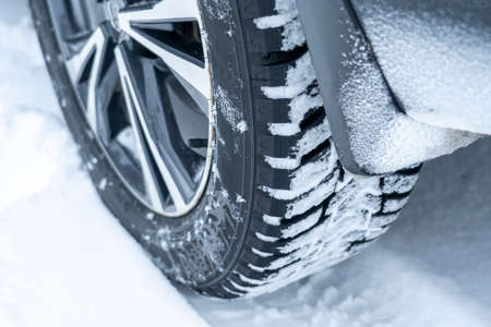 winter tires of a white modern crossover close-up