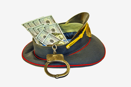 Uniform caps in dollars and in handcuffs