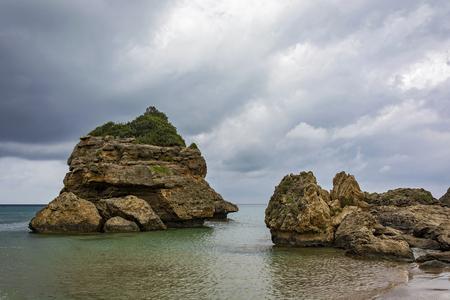Stone blocks of volcanic origin on the coast of the island of Zakynthos (Greece) Stock Photo