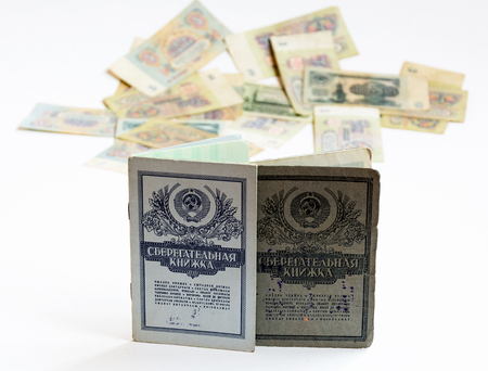 Savings books of the Soviet Union, are standing upright. In the background is seen the Soviet rubles without harshness Reklamní fotografie