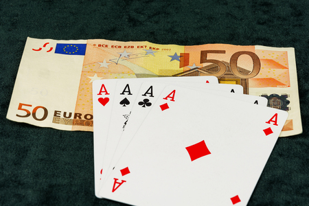 four objects: On banknotes card is a combination of four aces Stock Photo