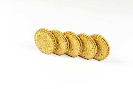 On a light background a round biscuit with chocolate filling