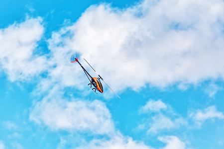 The flight of a radio-controlled 3D helicopter Stock Photo