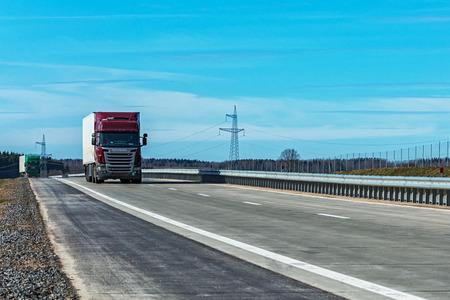 goods train: Belarus, Minsk region - 03.23.2017: Heavy goods truck on the highway Editorial