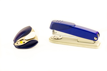 A stapler and anti-stapler lie on a white background