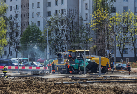 manage transportation: Belarus, Minsk - 06.05.2017: Special equipment for laying asphalt on the construction of a new road Editorial
