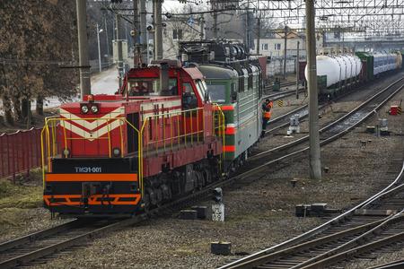 Belarus, Minsk - 03042017: Shunting diesel locomotive pulls the train at the railway yard