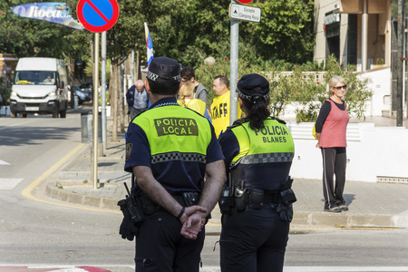 Spain, Blanes - 09232017: Police stand at the crossroads of the city street
