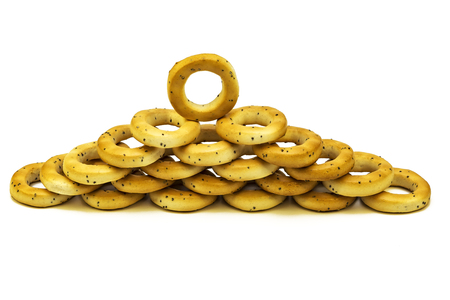 On a white background poppy bagels are stacked on each other Stock Photo