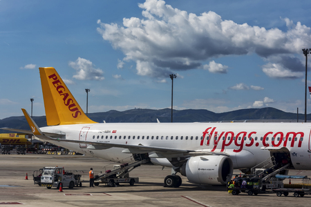 Spain, Barcelona - 26.09.2017: Unloading of the airplane by postal PEGASUS service at the airport