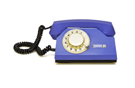 Retro telephone with a round dialer on a white background