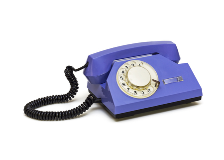 On a white background is a retro telephone with a round dialer Stock Photo