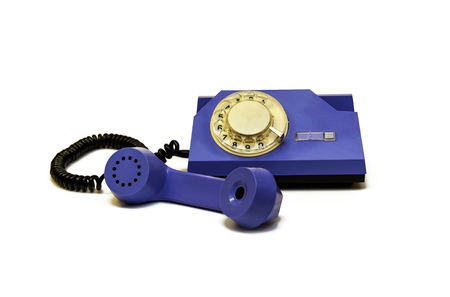 Retro telephone with a round dialer is on a white background