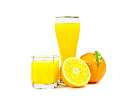 On a white background is two glasses of freshly squeezed orange juice, lying next to a whole orange and half orange
