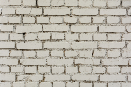 Wall from an old brick of white color on a cement mortal