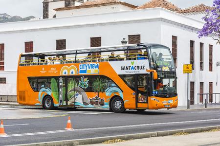 Spain, Tenerife - May 13, 2018: tourist bus Puerto Santa Cruz on the city street