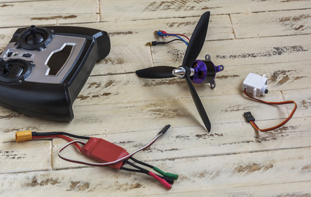 On the wooden surface are the details of the radio-controlled drone